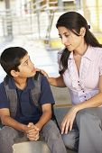 stock photo of school building  - Unhappy Pre teen boy in school - JPG
