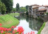 stock photo of vicenza  - Bacchiglione River which crosses the Santa Croce district in Vicenza in Italy