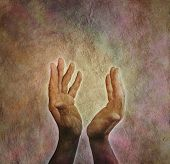 picture of qi  - Male hands outstretched with parchment aged paper background - JPG