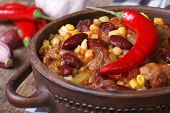stock photo of stew pot  - Mexican hot chili con carne soup in a tureen closeup horizontal