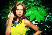 image of tropical rainforest  - Attractive young woman  among the tropical plants - JPG