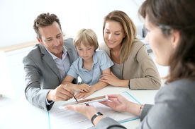 picture of family planning  - Family signing home purchase contract on tablet - JPG