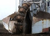 stock photo of collier  - Large excavator digging coal at surface coal mine - JPG
