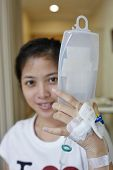 foto of tubes  - Patient Hold her IV drip tube to go to toilet - JPG