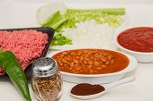 stock photo of poblano  - Chilli making ingredients on a white counter  - JPG