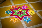 stock photo of rangoli  - The purpose of rangoli is decoration and it is thought to bring good luck - JPG