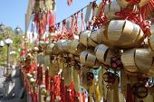 stock photo of sinful  - Buddhist Prosperity Bell in Wong Tai Sin Temple Hong Kong - JPG
