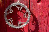 picture of door-handle  - recycled bike crank as a door handle on a red vintage door - JPG