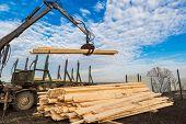 image of logging truck  - Tree log hydraulic manipulator  - JPG