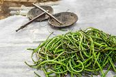 stock photo of yard sale  - Organic local yard long beans for sale at outdoor asian marketplace - JPG