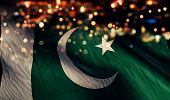 image of pakistani flag  - Pakistan National Flag Light Night Bokeh Abstract Background - JPG