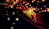 foto of papua new guinea  - Papua New Guinea National Flag Light Night Bokeh Abstract Background - JPG