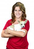 picture of mexican-dog  - Woman carrying a small chihuahua dog isolated on white - JPG