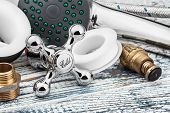 picture of plumbing  - plumbing and accessories on wooden table industry - JPG