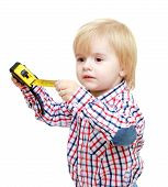 pic of montessori school  - little boy with a tape measure - JPG