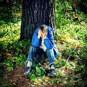 picture of sorrow  - The Sorrowful Teenager sitting in the Forest - JPG
