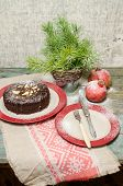 foto of desert christmas  - Still life with chocolate cake Christmas tree and pomegranate. Rustic style. From the series Baking for Holidays