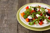 picture of beet  - salad of roasted beets and pumpkin with feta cheese and arugula on a plate on a wooden background - JPG