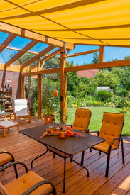 picture of canopy roof  - View from a cozy winter garden in the large natural garden in summer - JPG