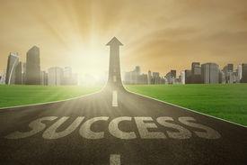 stock photo of arrow  - Highway with Success word turning into arrow upward symbolizing the way to success - JPG