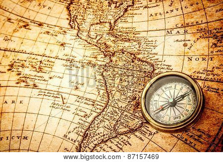 Vintage still life. Vintage compass lies on an ancient world map ...