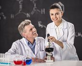foto of professor  - Senior chemistry professor and his assistant working in laboratory - JPG