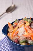 stock photo of crockery  - Frozen vegetables in a crockery before roasting  - JPG