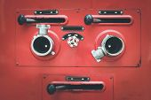 stock photo of fire truck  - Close up red Fire truck hose connectors - JPG
