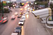 image of cctv  - Close up Security CCTV camera operating over the road - JPG