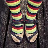 stock photo of emo  - Female legs in striped socks in vintage style - JPG