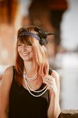 stock photo of headband  - Flapper girl portrait - JPG