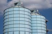 stock photo of silos  - two blue silos in a port area - JPG