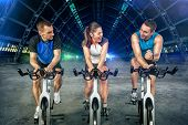 picture of cardio  - Young people  doing spinning on cycle bike - JPG