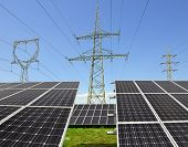 image of electricity pylon  - Solar energy panels with electricity pylons  - JPG