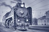 image of locomotive  - Retro steam locomotive stands on the station at evening time - JPG