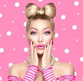 picture of bowing  - Beauty Surprised fashion model girl with funny bow hairstyle - JPG