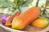 stock photo of pawpaw  - Papaya fruit is placed in the tray - JPG