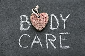 pic of pumice-stone  - body care phrase handwritten on blackboard with heart symbol made from pumice - JPG