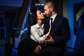 stock photo of office romance  - Couple indoors - JPG