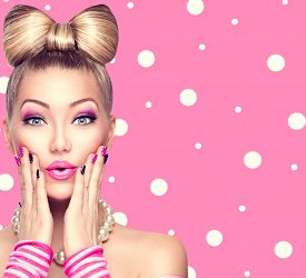 picture of emotion  - Beauty Surprised fashion model girl with funny bow hairstyle - JPG