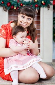picture of new years baby  - Portrait of young mother and her baby daughter - JPG