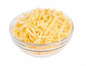 stock photo of grating  - Glass bowl of grated cheese isolated on white - JPG