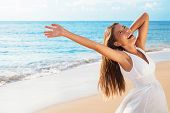 Freedom woman on beach enjoying life with open arms feeling free bliss and success on beach. Happine poster
