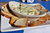 pic of dipping  - Serving of Crab and Artichoke Dip with Toast Points - JPG