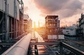 Pipeline And Pipe Rack Of Industrial Plant With Sunset Sky Background, Manufacturing Of Petrochemica poster