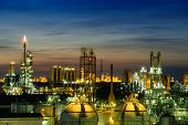 Gas Storage Sphere Tanks In Petrochemical Industry Or Oil And Gas Refinery Plant On Twilight Sky Bac poster