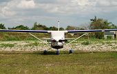 picture of cessna  - Front view of Cessna airplane parked at remote airport - JPG