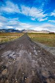Endless Dirt Road And Blue Sky In Iceland poster