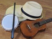 A Samba Player (sambista) Hat And Three Brazilian Musical Instruments: Cavaquinho, Pandeiro (tambour poster