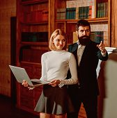 Online Concept. Bearded Man And Sensual Woman Use Digital Library Online In Laptop. University Onlin poster
